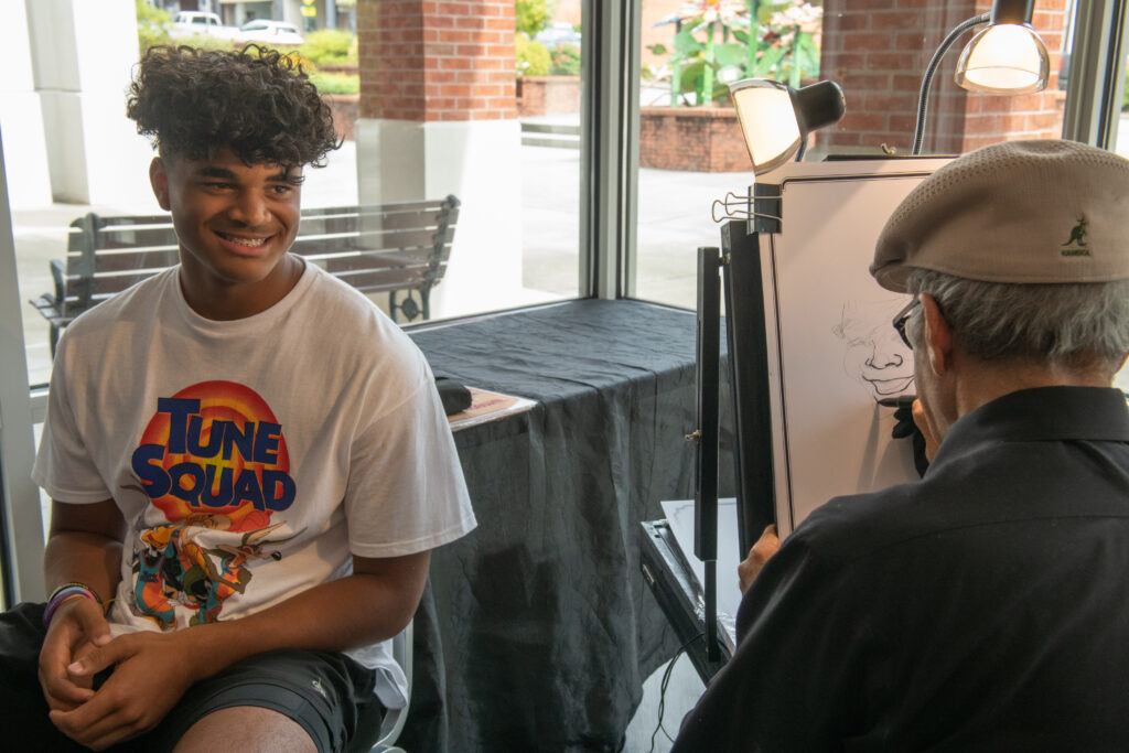 Attendee enjoys having his caricature drawn at Cerrowire's 100-Year Anniversary Celebration.