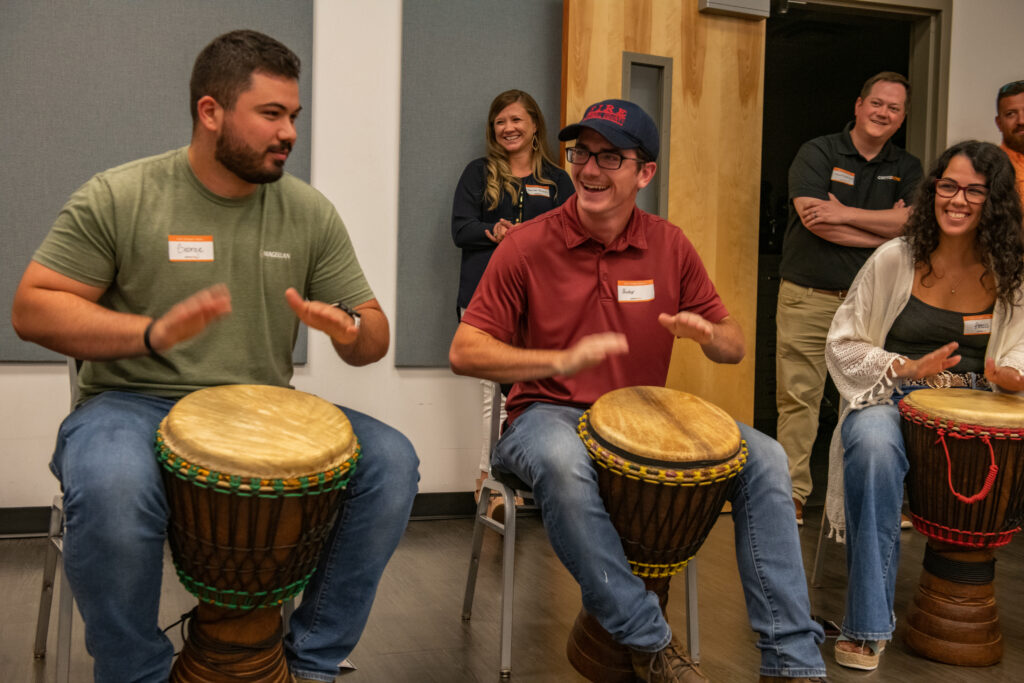 Celebrants keep the beat in drumming class during Cerrowire's 100-Year Anniversary Celebration in Georgia.